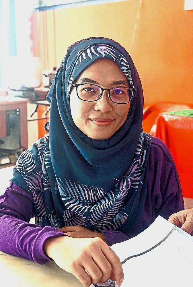 Nur Fadhilah (left) and Norhayati are volunteers for Perak PBS.