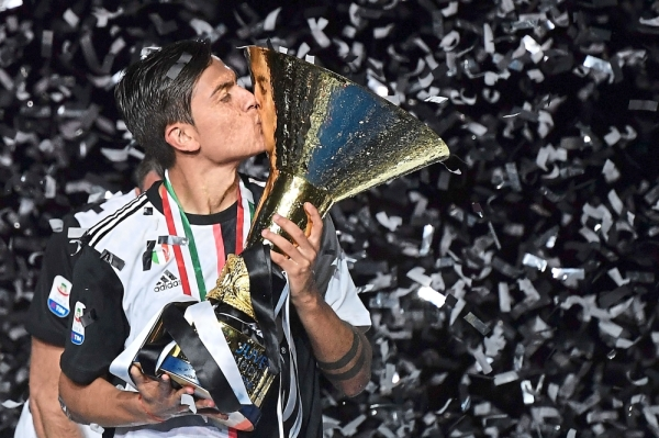Dybala kissing the Serie A trophy after Juventus were crowned champions last month. Fans will be able to catch the team live in action at the ICC Singapore next month. — Filepic