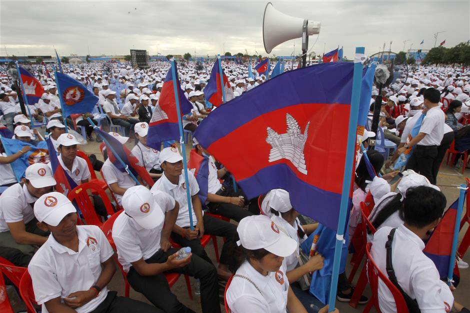 FILE - In this July 7, 2018, file photo, supporters wait for the start of a campaign rally of Cambodian Prime Minister Hun Sen\'s Cambodian People\'s Party in Phnom Penh, Cambodia. A California-based security-research firm said Wednesday, July 11, 2018, that it found evidence that an elite Chinese government-linked hacking team has penetrated computer systems belonging to Cambodia\'s election commission, opposition leaders and media in the months leading up to Cambodia\'s July 29 election. (AP Photo/Heng Sinith, File)
