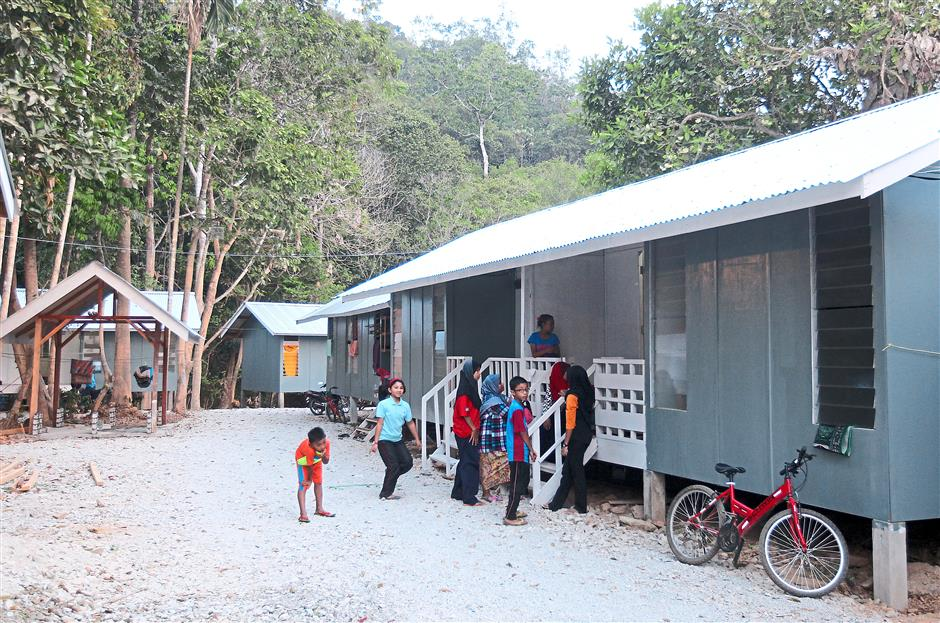 Transit homes like these built by Mercy Malaysia in Kampung Tualang give the flood victims a sense of normalcy and community.