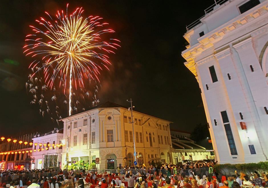 Fireworks lighting up the sky at the Penang state Chinese New Year celebration at Beach Street in George Town. — Photos: ZHAFARAN NASIB/The Star