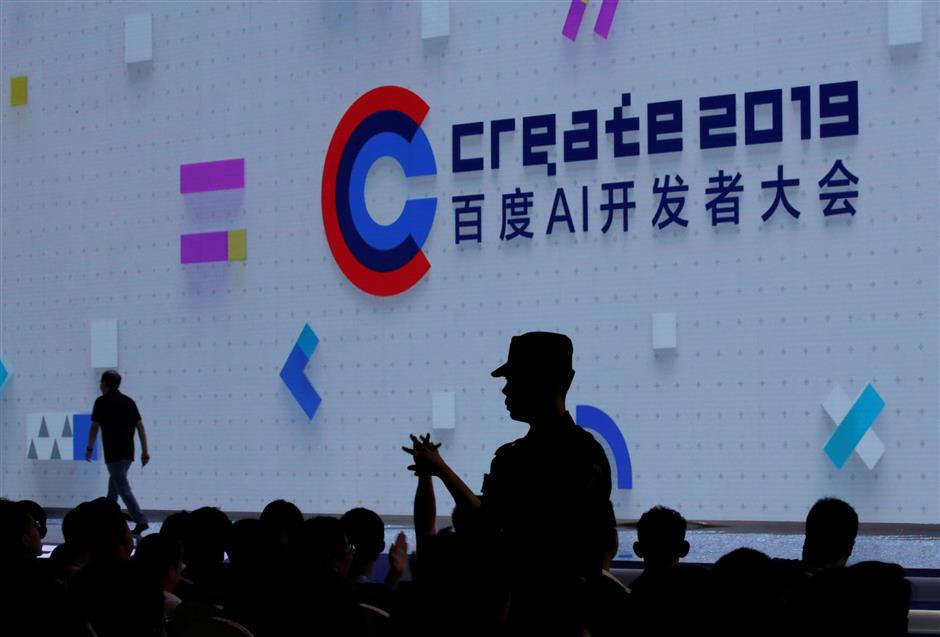 A security personnel stands guard among the delegates after a man poured a bottle of water over Baidu Inc Chief Executive Robin Li at the opening session of Baidu\'s annual AI developers conference Baidu Create 2019 in Beijing, China, July 3, 2019. REUTERS/Jason Lee