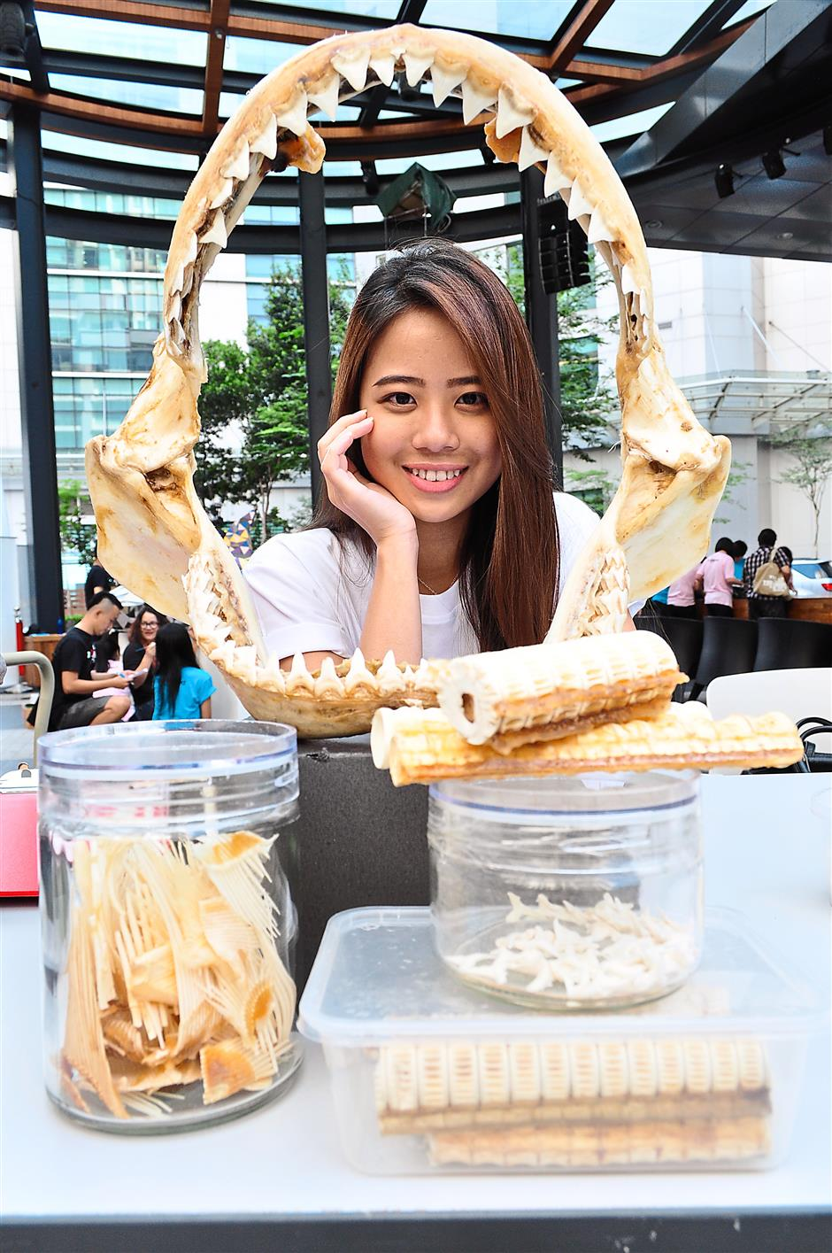 Not for consumption: Ivy Yap from Aquaria showing shark parts, which include the (clockwise) jaw, cartilage, teeth and fins.