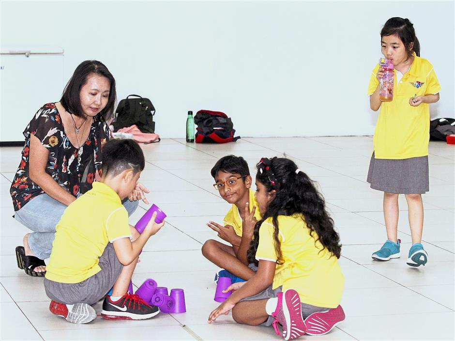 Teachers pets: Lim interacting with the students at the school.