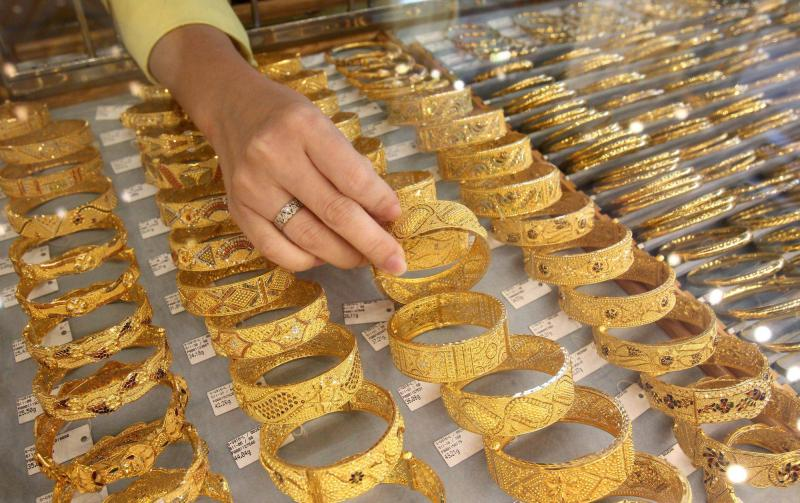 Spot gold rose 0.5% to US$1,233.90 an ounce by 0342 GMT as the dollar eased from its seven-week high with investors booking profits ahead of the US jobs report.
