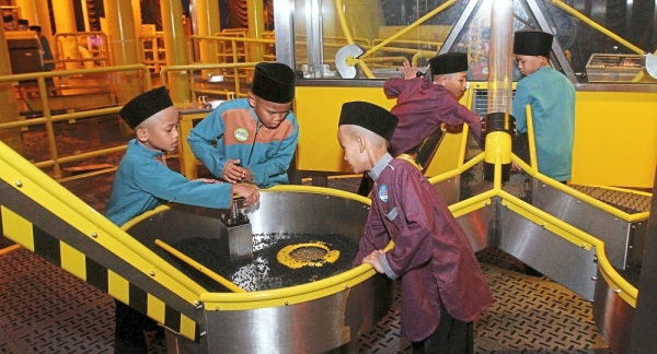 The children trying out the some of the activities at Petrosains, The Discovery Centre.