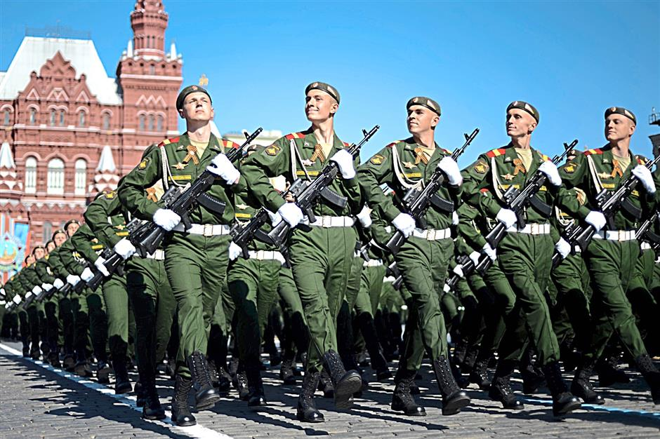 Russian soldiers march at the Red Square in Moscow yesterday during a Victory Day parade. Thousands of Russian troops marched  in Red Square to mark 69 years since victory in World War II in a show of military might amid tensions in Ukraine following Moscow's annexation of Crimea.- AFP