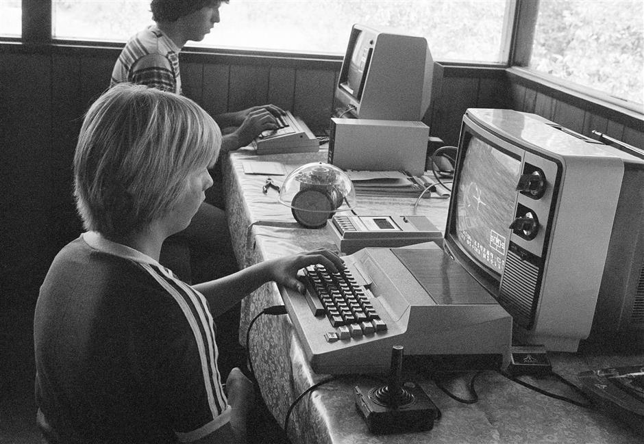 FILE- In this July 29, 1980, file photo, Greg Berman, 12, of Santa Barbara, Calif., sits at computer console at California Computer Camp near Santa Barbara. Todayu2019s grandparents may have fond memories of the u201cgood old days,u201d but history tells us that adults have worried about their kidsu2019 fascination with new-fangled entertainment and technology since the days of dime novels, radio, the first comic books and rock nu2019 roll. (AP Photo/Hyman, File)