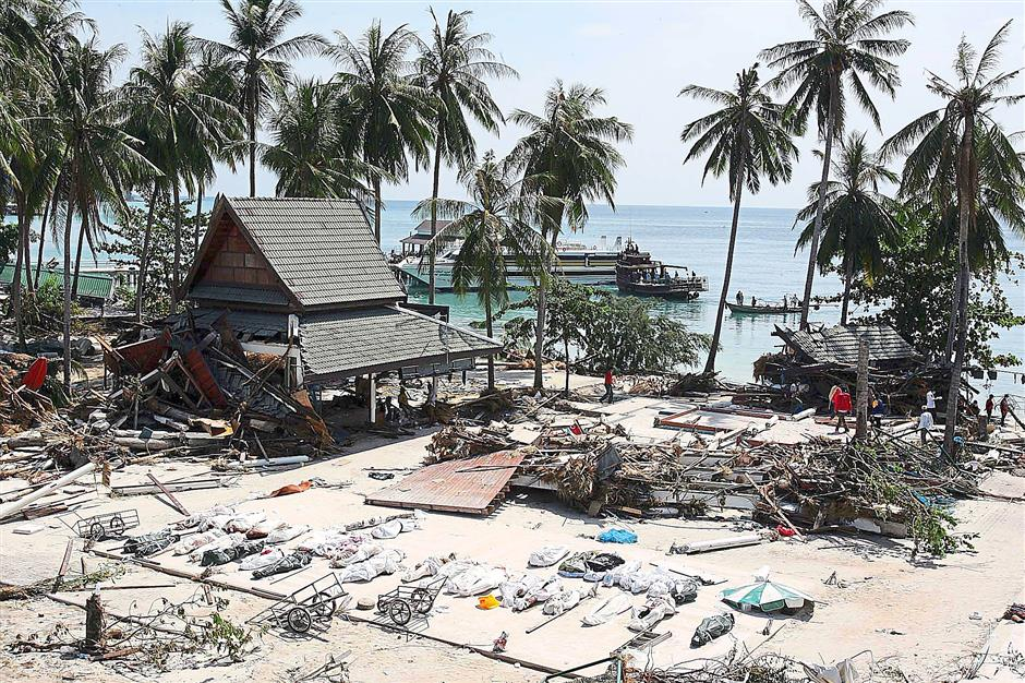 This was the scene on Dec 28, 2004, at Ton Sai Bay on one of the Phi Phi Islands: body bags line what used to be an idyllic beach. — File pic