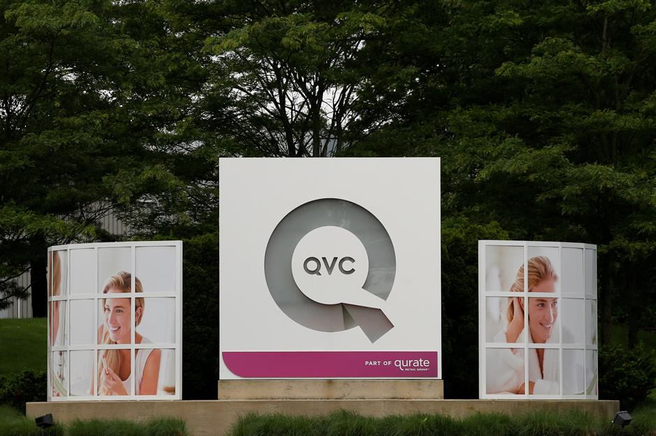 Signage is displayed at the entrance to the QVC Studio Park in West Chester, Pennsylvania, U.S., June 4, 2018. Picture taken June 4, 2018. REUTERS/Brendan McDermid.