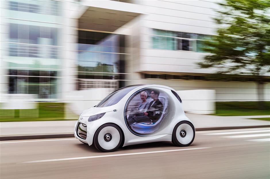 HANDOUT - Concept cars like the Smart vision EQwant to make it possible for drivers to sit back with their hands on their lap while their car does the driving. Photo: Daimler AG/dpa