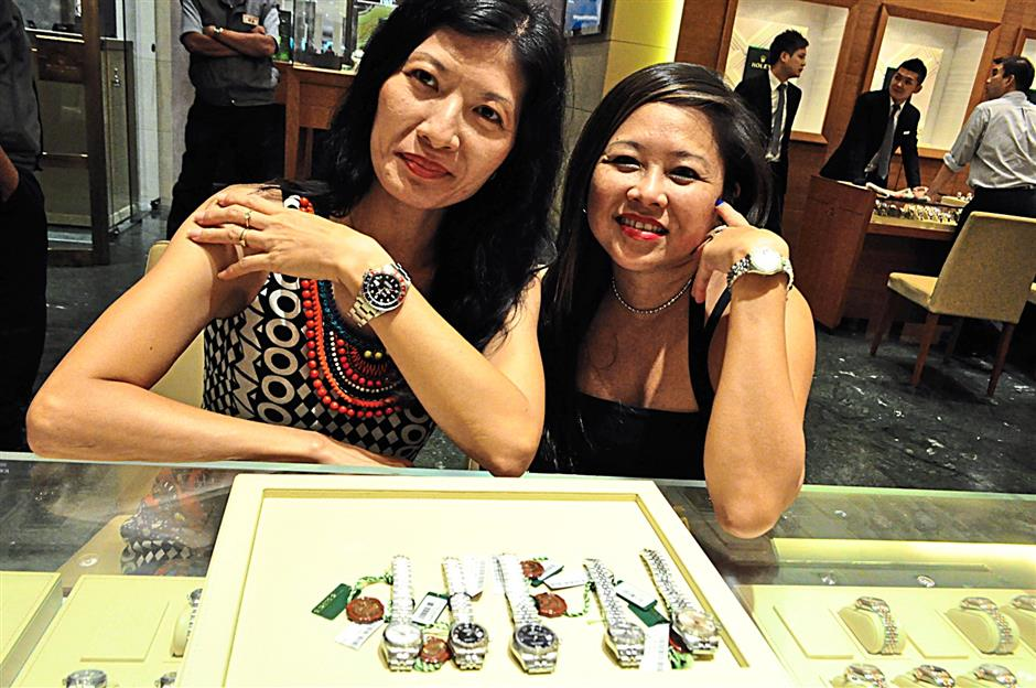 Djelita Japar (left) with her GMT Master and Mandovia Helerina wearing a Lady Datejust at Rolex's cocktail party at its boutique in Pavilion Kuala Lumpur.