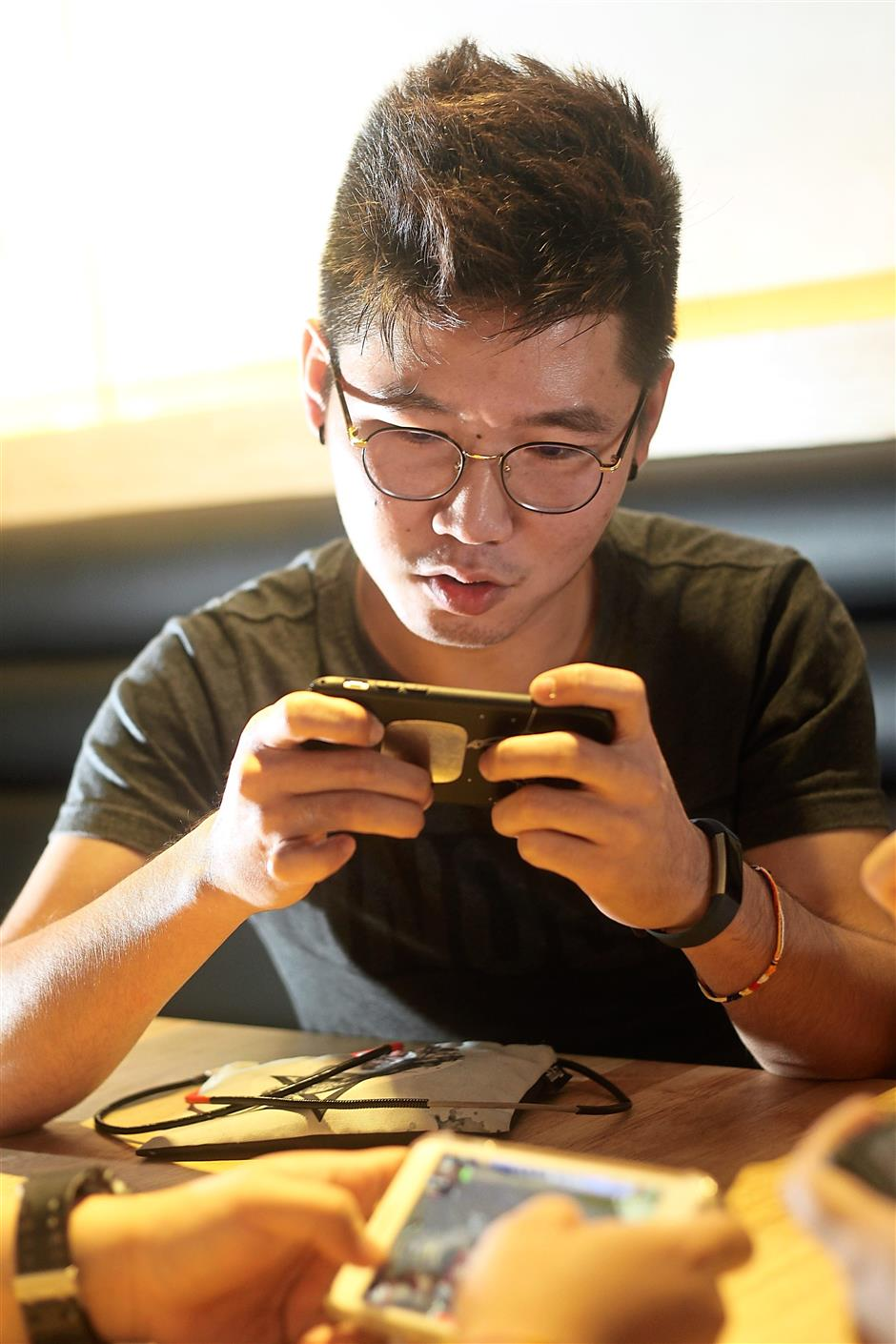 Vincent Yang often plays PUBG Mobile as a squad with his friends, and they even meet up on weekends to spend hours on the game. — AZMAN GHANI/The Star