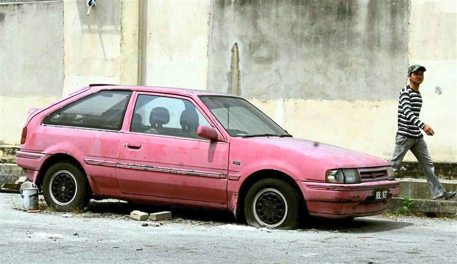 Abandoned cars with open doors or windows are the perfect place for water to collect allowing mosquitos to breed