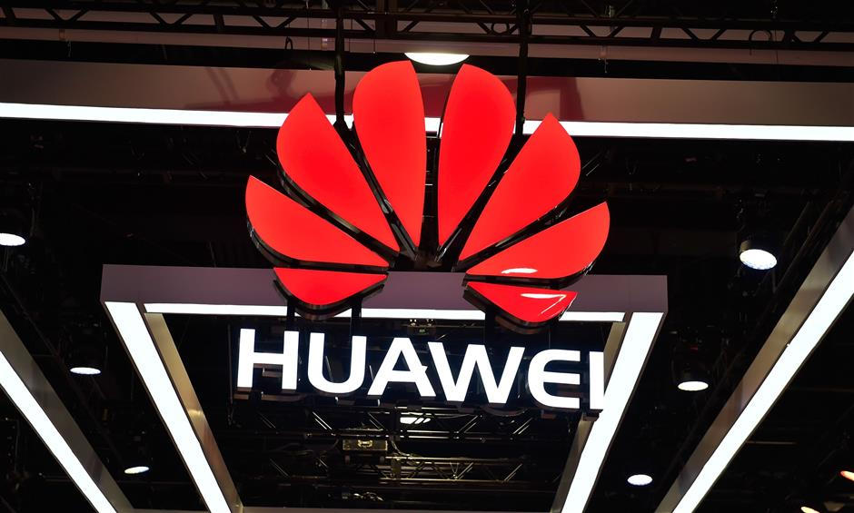 LAS VEGAS, NV - JANUARY 09: The Huawei logo is display during CES 2018 at the Las Vegas Convention Center on January 9, 2018 in Las Vegas, Nevada. CES, the world's largest annual consumer technology trade show, runs through January 12 and features about 3,900 exhibitors showing off their latest products and services to more than 170,000 attendees.   David Becker/Getty Images/AFP == FOR NEWSPAPERS, INTERNET, TELCOS & TELEVISION USE ONLY ==