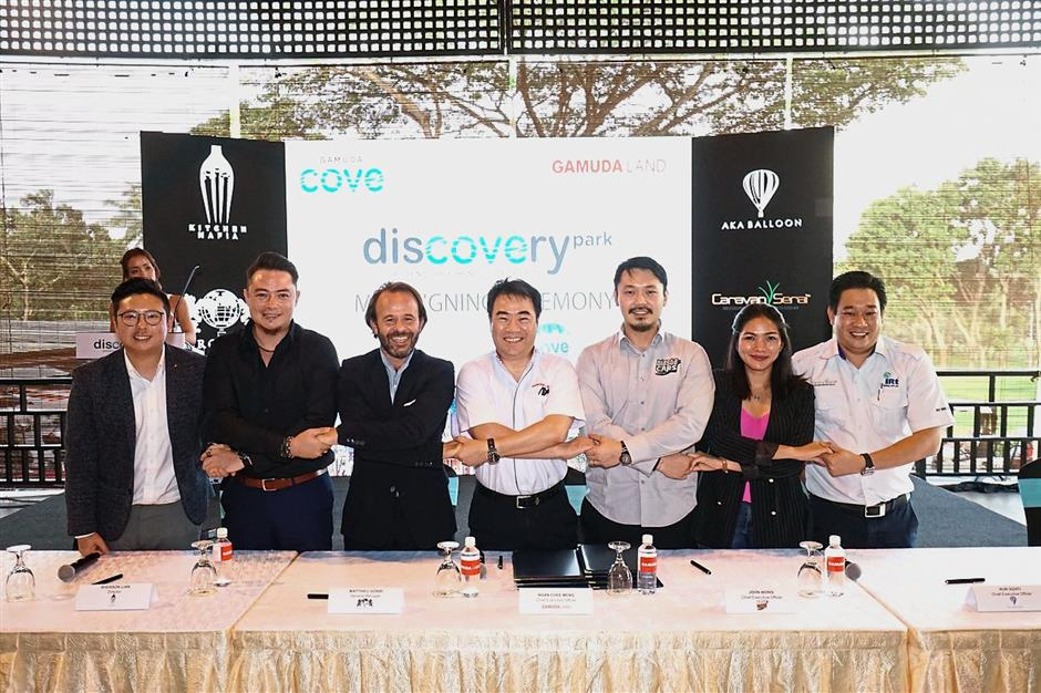 (From left) Invade CEO Kent Teo, Kitchen Mafia director Sherson Lian, Aerophile Group general manager Matthieu Gobbi, Gamuda Land CEO Ngan Chee Meng, Blastacars Malaysia CEO John Wong, AKA Balloon CEO Nur Izzati Khairudin and Caravan Serai managing director Chua Teck Huang after signing the MoU.