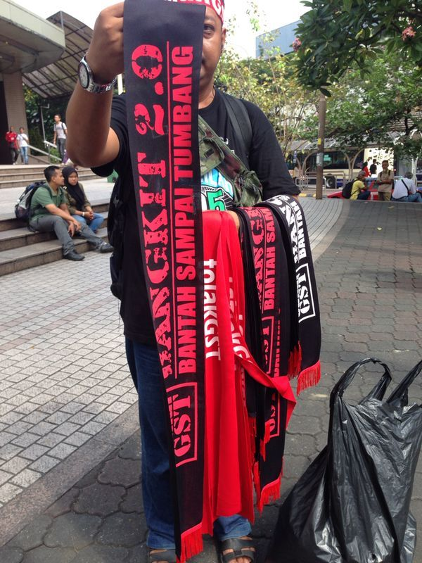Peddlers selling scarfs to commemorate the Anti-GST rally.