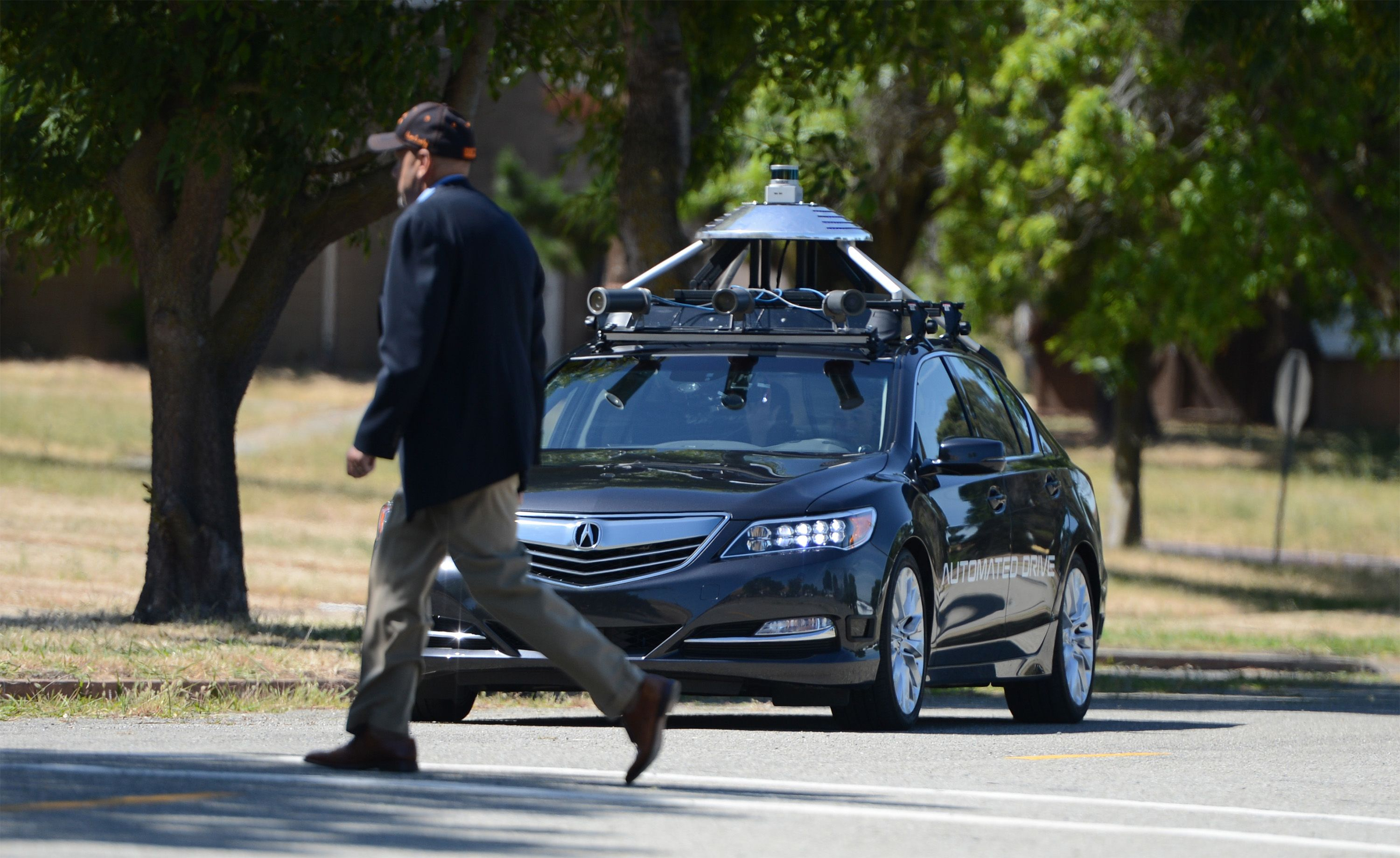 An Acura RLX equipped with autonomous vehicle technology slows to avoid a pedestrian in a sidewalk as it is demonstrated at the former Concord Naval Weapons Station on June 1, 2016 in Concord, Calif.(Kristopher Skinner/Bay Area News Group/TNS)