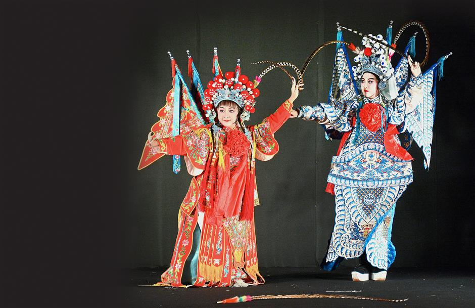 Wei Tian (left) and Yap Ting performing an excerpt from the Chinese classic tale, Butterfly Lovers, at the Cheah Kongsi in George Town, Penang. u2014 Photos: JEREMY TAN/The Star