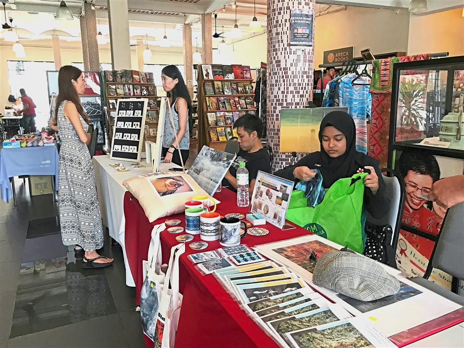 Visitors checking out the items at the Artisan Market and Garage Sale at The Star Pitt St in George Town. — Photos: ZAINUDIN AHAD/The Star
