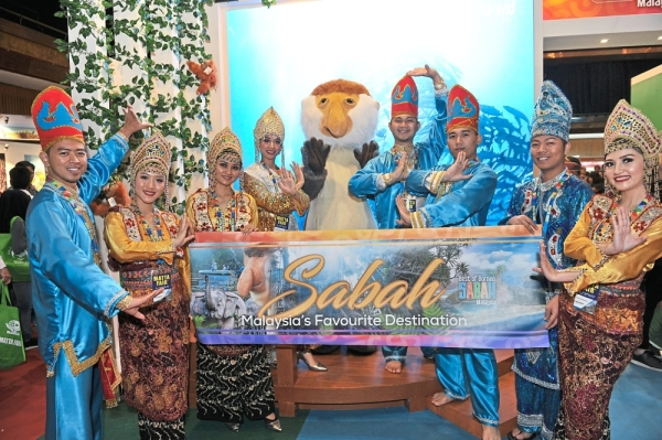 """Performers welcoming visitors to Sabah's booth. Sabah was designated as """"Malaysia's Favourite Destination""""."""