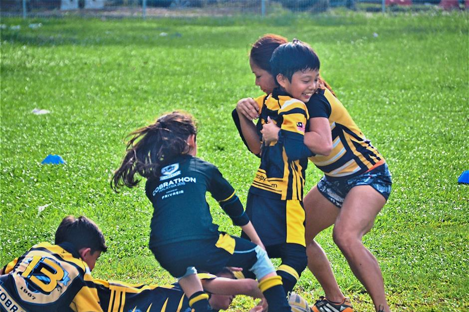 Tackling is one of the skills being taught during a Cobrats training session.