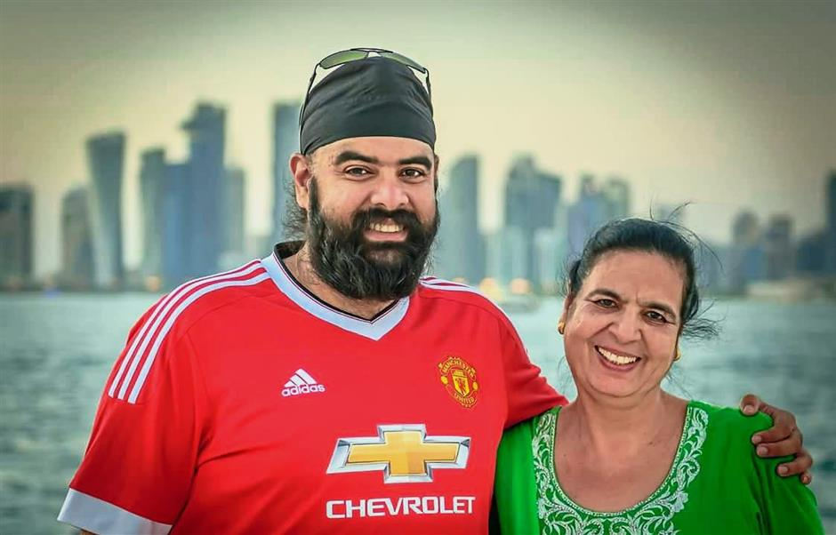 Jagjit (left) with his mother Gurmeet Kaur in Doha. He will indulge in some nasi lemak before casting his vote.