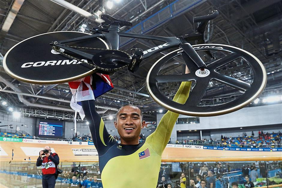 Overjoyed: Azizulhasni Awang celebrating after winning gold in the men's keirin final at the Track World Championships last year. — Reuters