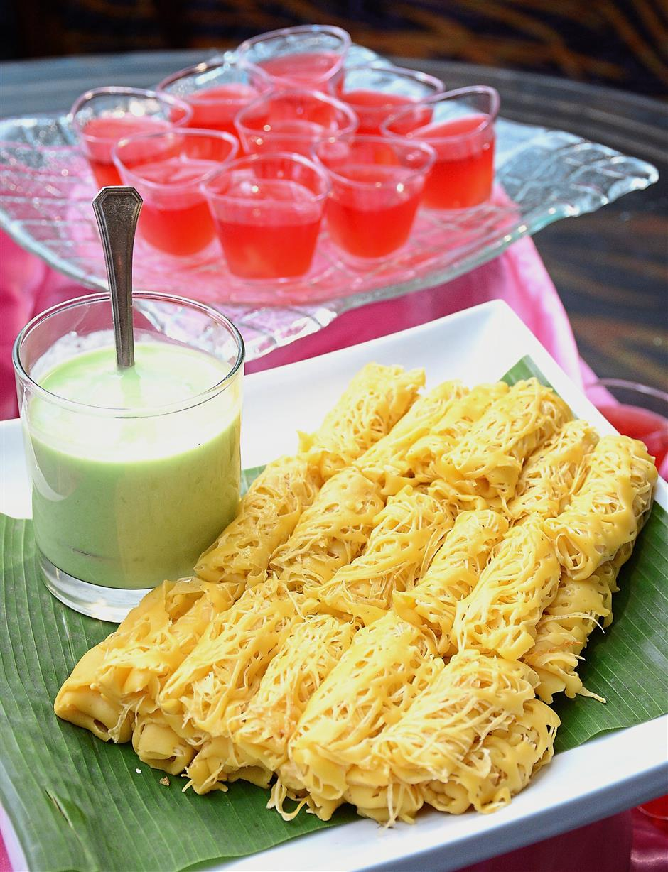 Desserts may include the special Roti Jala with Kuah Manis (front) alongside puddings and jellies. — Photos: JEREMY TAN/The Star
