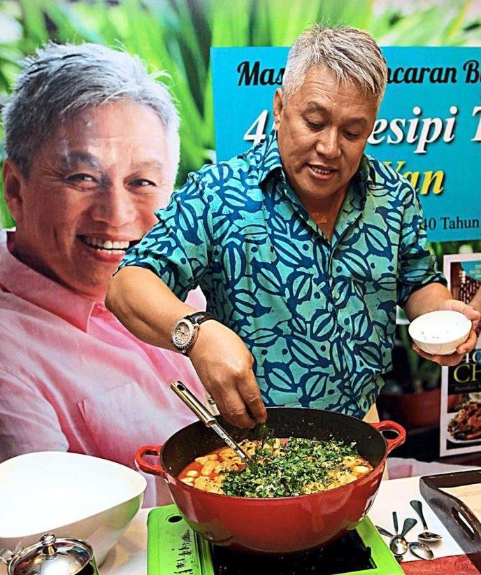 Cooking with gusto: Chef Wan demonstrating how to cook a laksa dish at the launch of his latest book '400 Resipi Terbaik Chef Wan'.