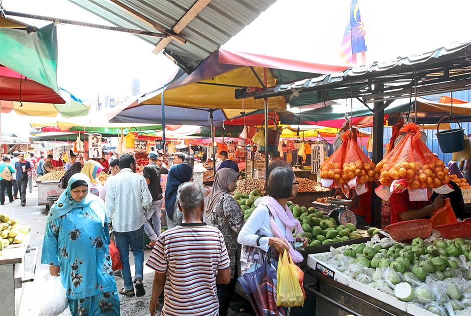Sandra Bambang and her Indonesian friends enjoy shopping at the market in Kampung Baru since they can find most Indonesian ingredients there