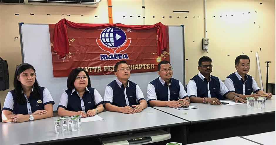 Mohamad Hisam (third from right) at the press conference on the upcoming MATTA fair in Ipoh Parade.