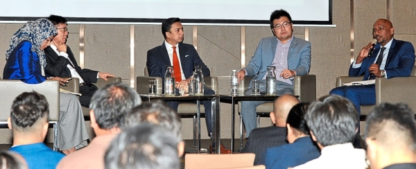 Exchanging ideas: The panellists (from right) Prakash, Ling, Segar and Tang, with Sabariah (extreme left) as moderator, at the Export Excellence Awards 2019 roadshow.