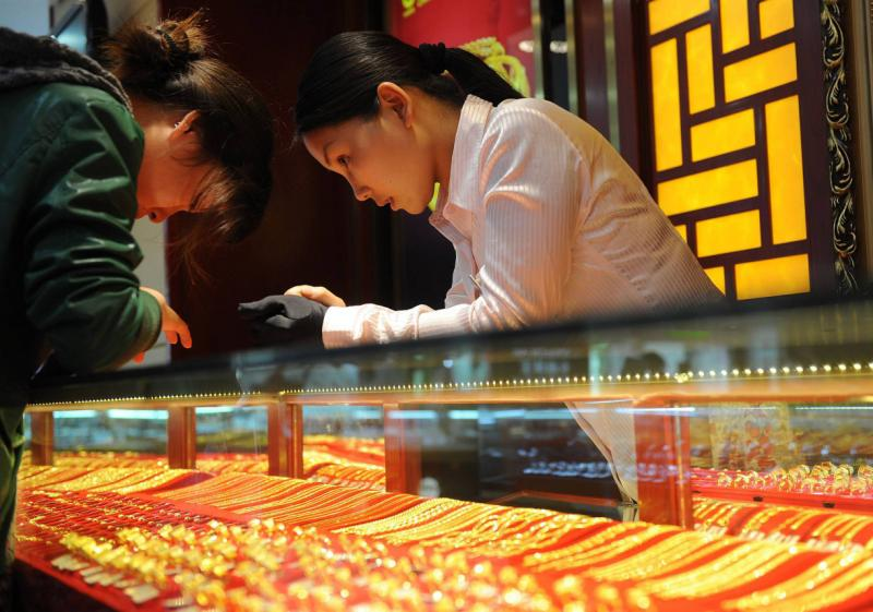 Demand for gold from China has jumped nearly 40% this year as the appetite for jewellery, bars and coins increased sharply due to the sharp drop in gold prices - AFP Photo.