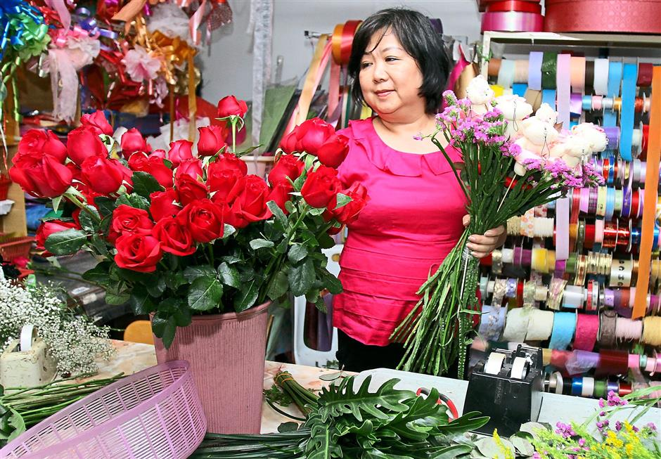 Still popular: Chew putting together a floral bouquet.