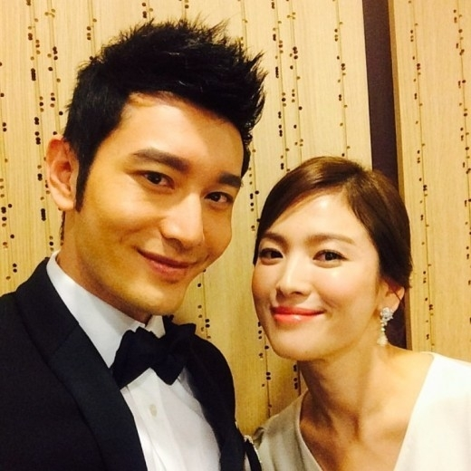 Huang Xiaoming sharing a selfie of him and his co-star from