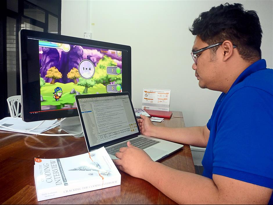 Constant upgrading: Reza working on the code for one of the company's educational apps.