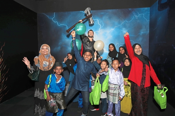 Children from four homes having fun at the Marvel Studios: Ten Years Of Heroes exhibition.