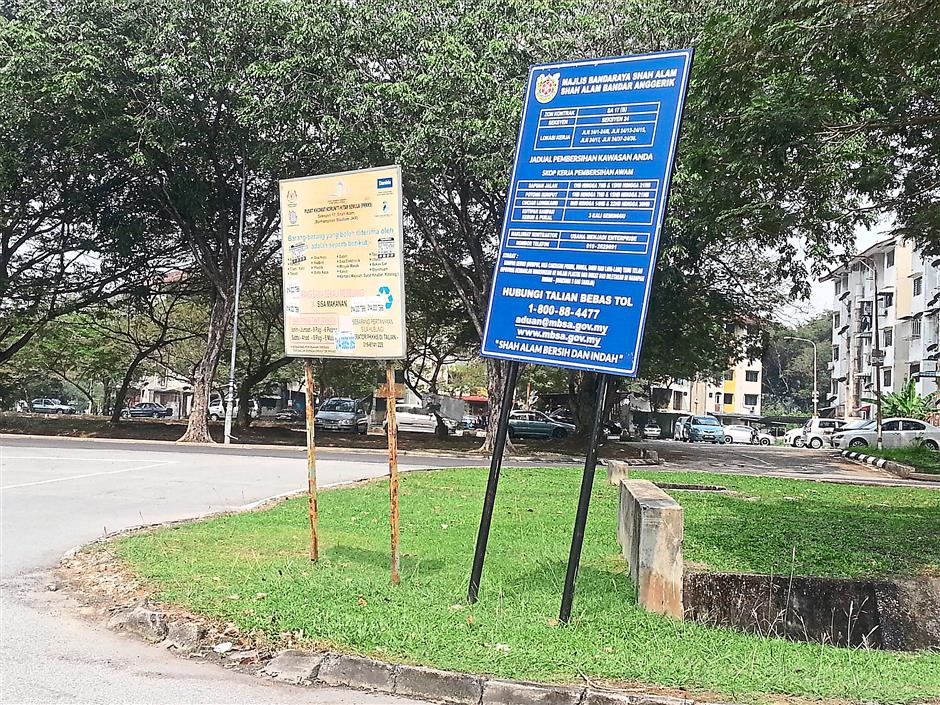 Unstable signboards like these in Shah Alam can be dangerous for passers by.