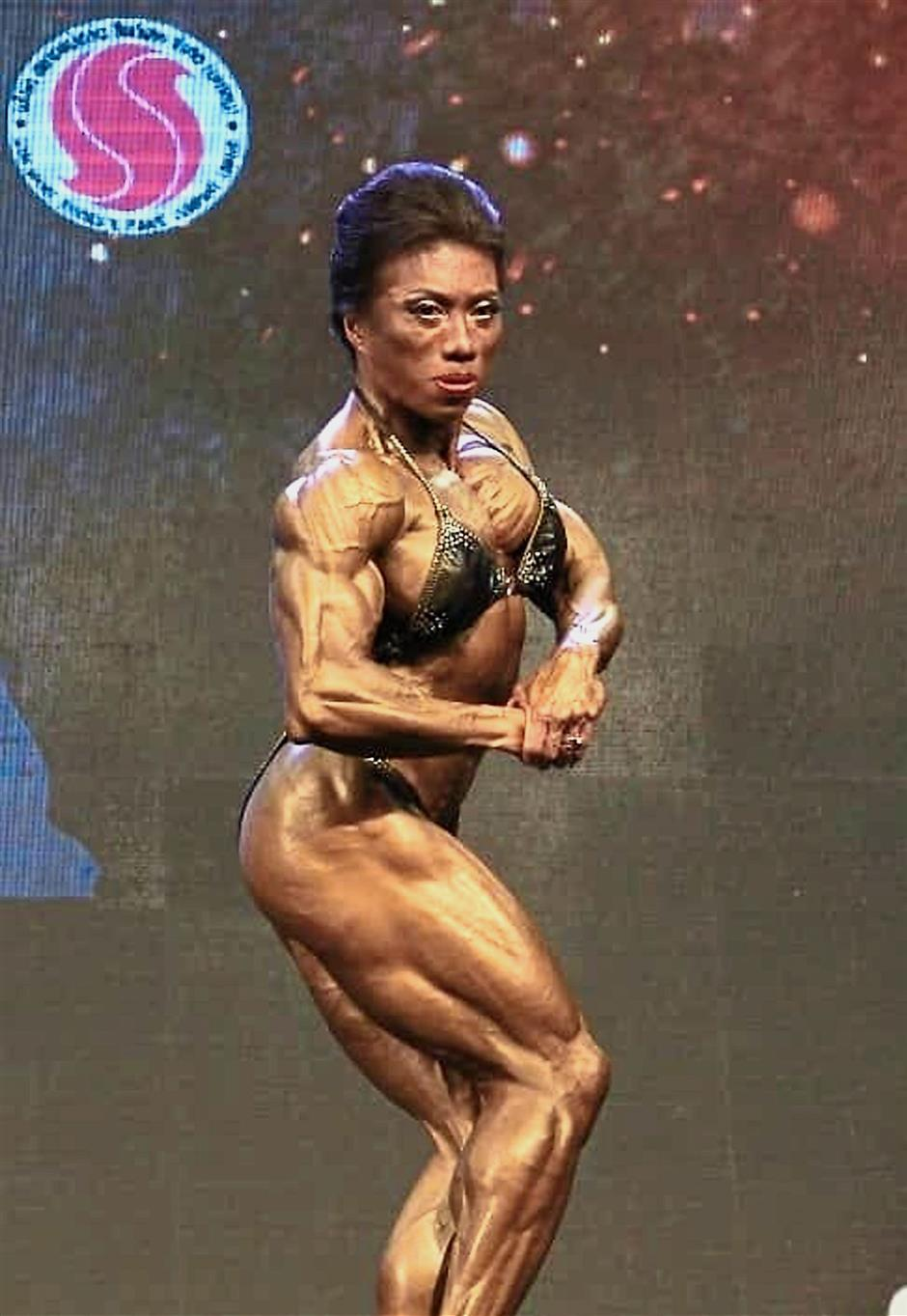 Flexing muscles: Lilian Tan's pose that won the women's 55kg category at the World Bodybuilding and Physical Fitness Championships in Chiangmai, Thailand.