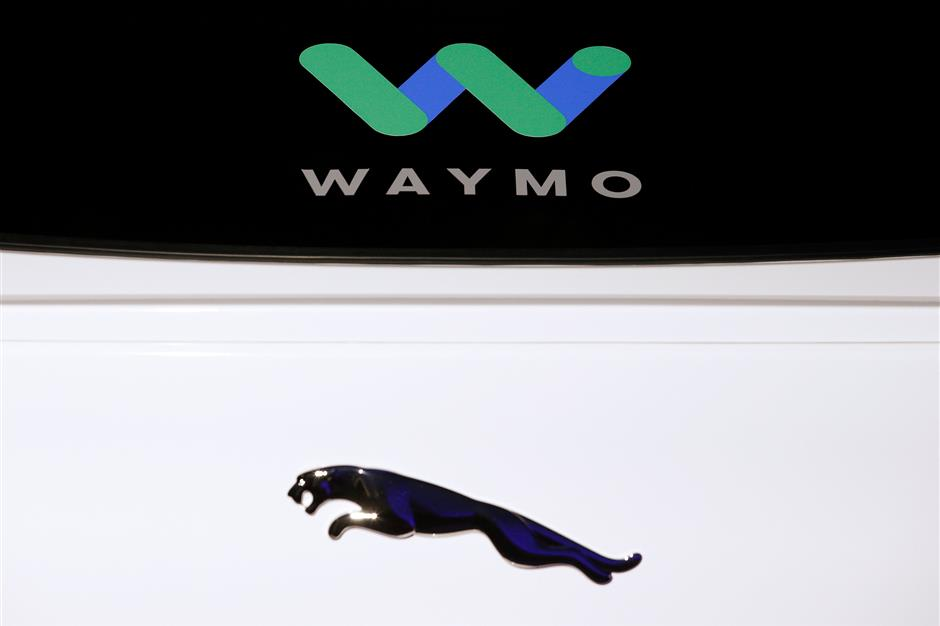 The logos of Jaguar and Waymo are pictured during a Jaguar I-PACE self driving car unveiling event by Waymo in the Manhattan borough of New York City, New York, U.S., March 27, 2018. REUTERS/Brendan McDermid