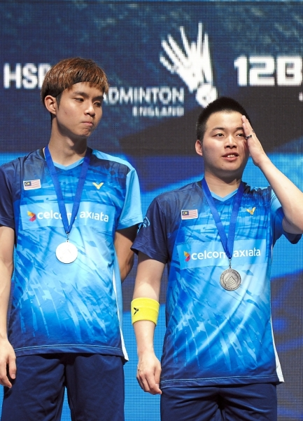 Bridesmaids: Soh Wooi Yik (left) and Aaron Chia posing with their runner-up medals on the podium after losing to Mohammad Ahsan and Hendra Setiawan of Indonesia in the menu2019s doubles final at the All-England on Sunday. u2014 AP