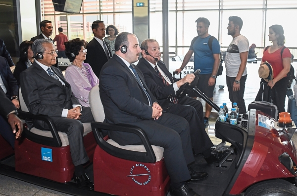 Guided tour: Dr Mahathir with Dr Siti Hasmah during a visit to ISGIA in Istanbul. u2014 Bernama