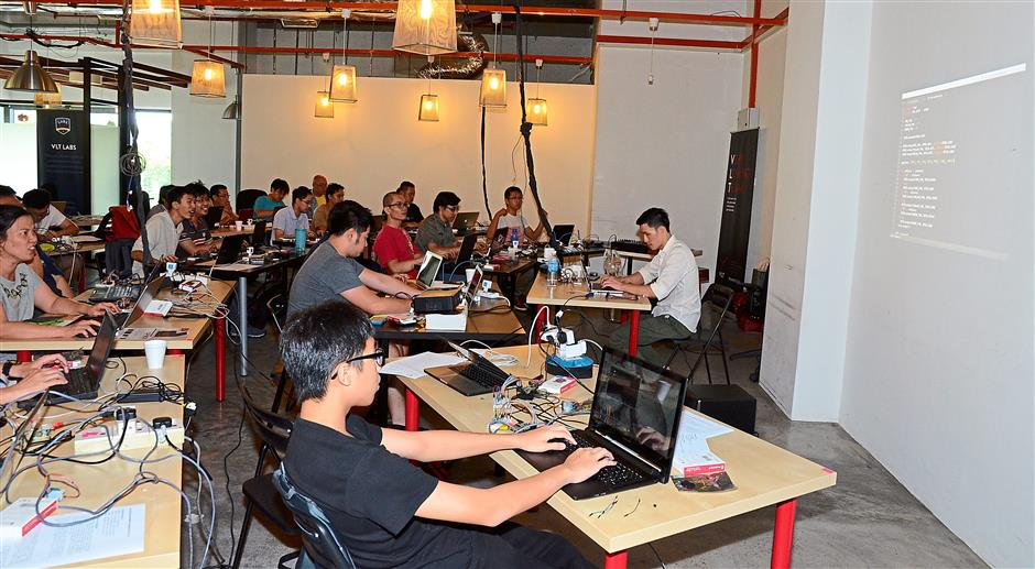 Full house: Hackerscape's inaugural workshop has been well-received, with participants of various backgrounds who were keen to learn about hardware hacking and programming.