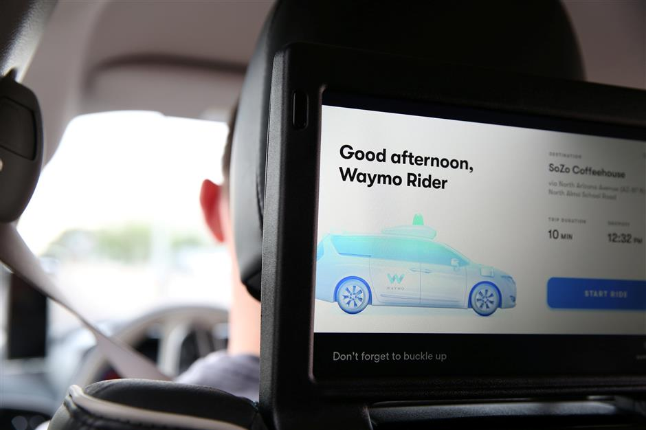 One of three screens displays the user interface inside a Waymo self-driving vehicle, during a demonstration in Chandler, Arizona, November 29, 2018. Picture taken November 29, 2018. REUTERS/Caitlin O'Hara