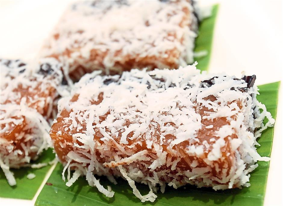 Dessert: End the meal on a sweet note with the Steamed New Year Cake with Shredded Coconut.