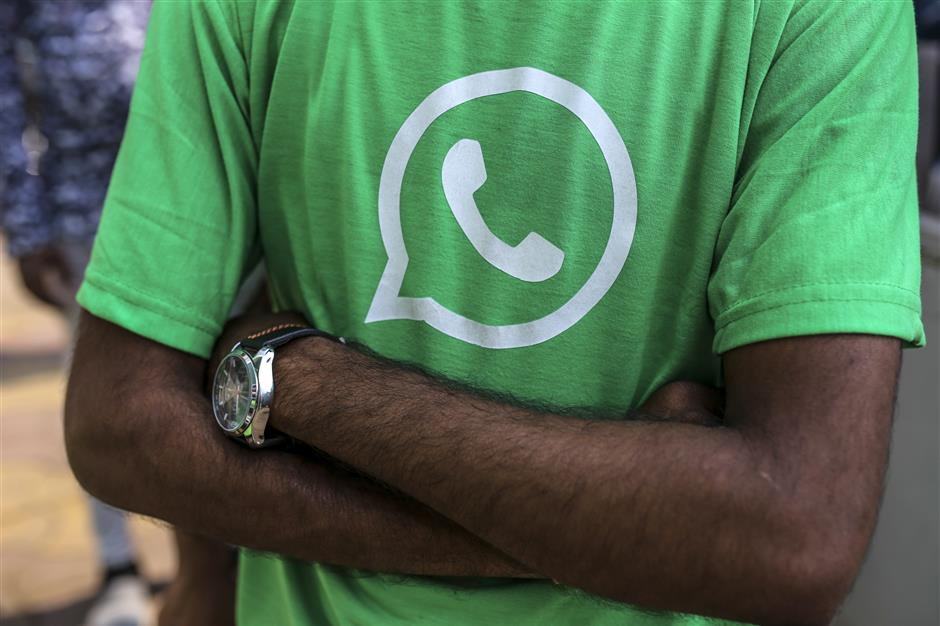The Facebook Inc. WhatsApp logo is displayed on a green t-shirt during a roadshow for the messaging service and Reliance Jio Infocomm Ltd.\'s wireless network in Pune, India, on Thursday, Oct. 25, 2018. Facebook and Reliance Jio are teaming up to draw hordes of customers with cheap phones, rock-bottom rates and handy messaging services. Photographer: Dhiraj Singh/Bloomberg