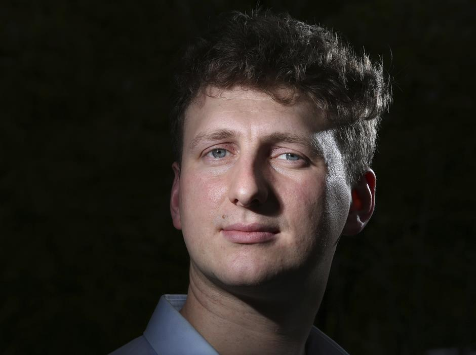 Aleksandr Kogan poses for a portrait Tuesday, July 2, 2018, in Buffalo N.Y. Kogan is at the center of the Cambridge Analytica privacy scandal says he is dropping a defamation suit against Facebook rather than endure a drawn-out legal battle he can ill afford. (AP Photo/Jeffrey T. Barnes)