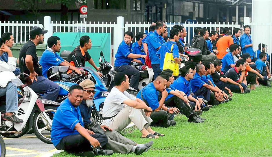 True-blue fans: Proton employees watching the match after work.