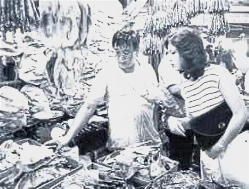 An old photo provided by Cheh of his waxed meat stall in the 1980s. On the left is his brother Cheh Yoong Chee. The stall was set up by their father Cheh Loke Cheng more than 50 years ago.